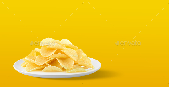 Potato chips in a plate on yellow background. with Copy space fo - Stock Photo - Images