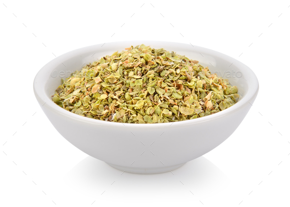 Oregano spice in a bowl on white background - Stock Photo - Images