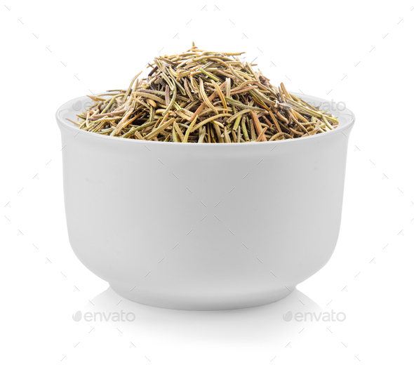Dried rosemary leaves in a bowl on white background - Stock Photo - Images