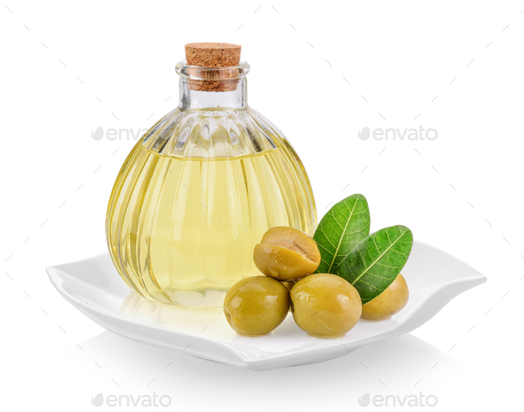 green olives and oil in plate (beautiful shape) on white backgro - Stock Photo - Images