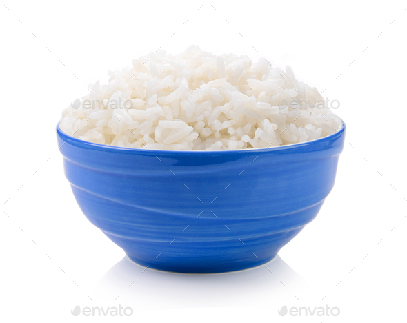 rice in blue bowl on white background - Stock Photo - Images