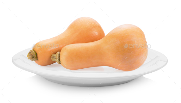 butternut squash in plate on white background - Stock Photo - Images
