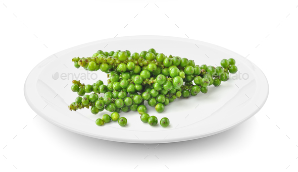 green pepper corn in plate on white background - Stock Photo - Images