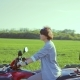 Adult and Beautiful Woman at the Wheel of an ATV in the Field, the Camera Rotates Around Her - VideoHive Item for Sale
