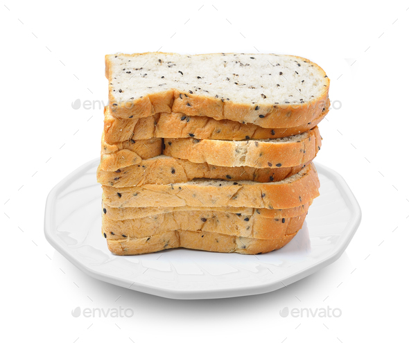 whole wheat bread in a plate on white background - Stock Photo - Images