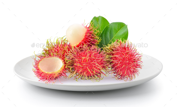 rambutan in plate isolated on a white background - Stock Photo - Images