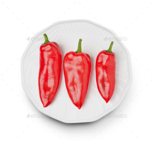 Sweet pepper in a plate on white background - Stock Photo - Images