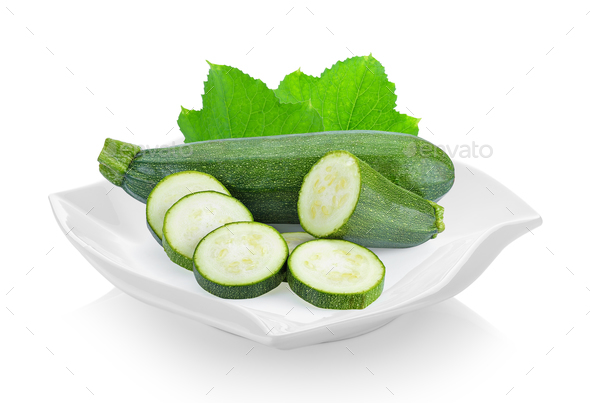 zucchini in ceramic plate (beautiful shape) on white background - Stock Photo - Images