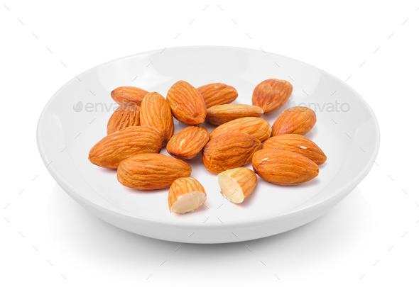 almond in plate on white background - Stock Photo - Images