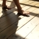 The Girl Walks on the Wooden Floor, Feet in the Sunlight. - VideoHive Item for Sale
