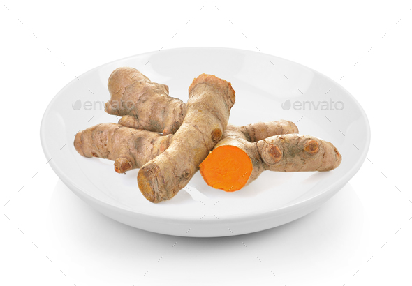 turmeric in plate on white background - Stock Photo - Images