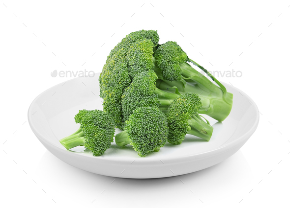Broccoli in plate on white background - Stock Photo - Images