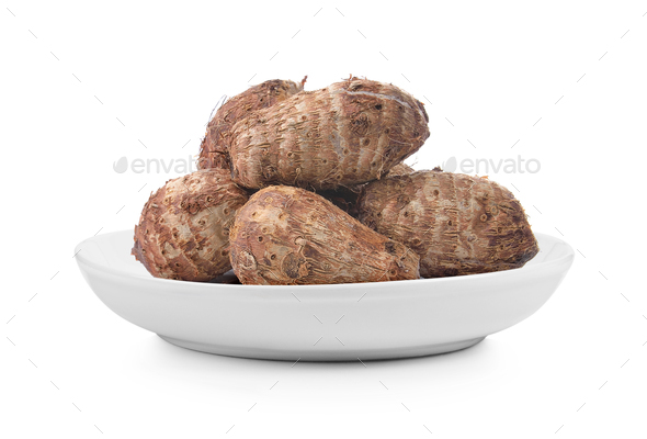taro root in plate on white background - Stock Photo - Images