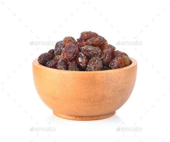 raisin on wood bowl isolated on white background - Stock Photo - Images