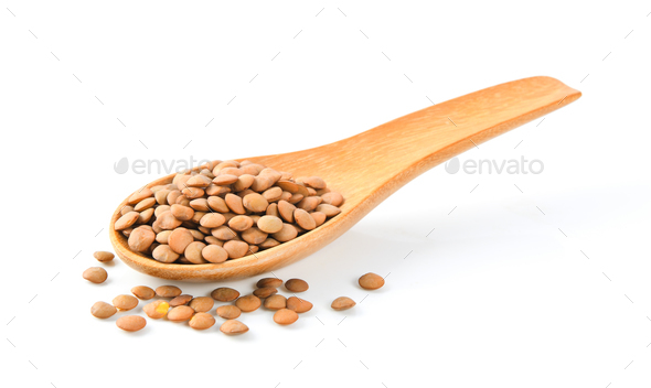 Brown Lentils in wooden spoon on white background - Stock Photo - Images