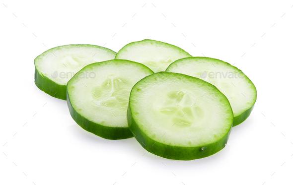 Fresh slice cucumber close-up on a white background - Stock Photo - Images