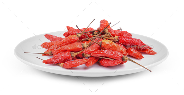 chili peppers in plate isolated on white background - Stock Photo - Images
