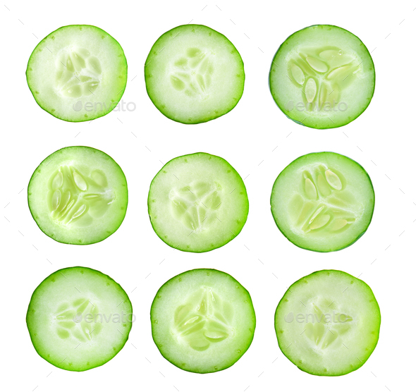 Cucumber slices isolated on white background. Top view - Stock Photo - Images