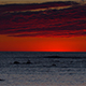 Sunset Over Ocean With Stones in the Foreground - VideoHive Item for Sale