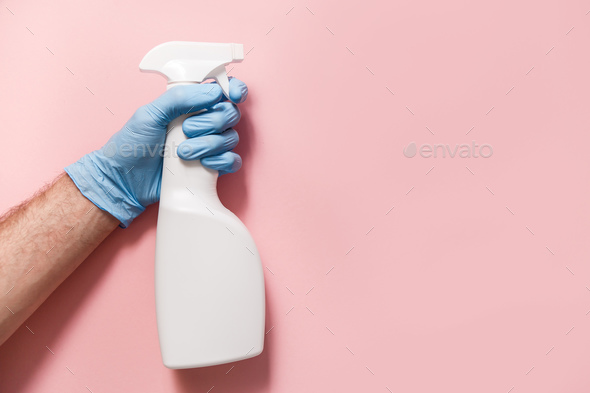 Cleaning Service Worker. Male hand with bottle of disinfectant - Stock Photo - Images