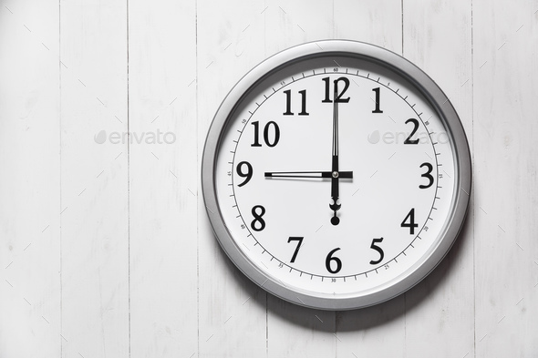 Clock on color wooden plank wall - Stock Photo - Images
