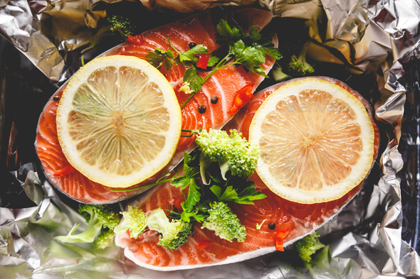 Raw sockeye salmon steaks on foil before baking in oven. - Stock Photo - Images