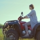 Adult and Beautiful Woman Driving a Quad Bike in a Field - VideoHive Item for Sale
