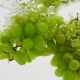 Bunch of Green Grapes Falling Into Water with Bubbles in - VideoHive Item for Sale