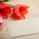 Red and pink tulips and blank greeting card on natural wooden ba - PhotoDune Item for Sale