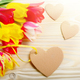 Colorful tulip flowers and heart shape cards on wooden table bac - PhotoDune Item for Sale