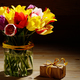 Bunch of Colorful tulip flowers in glass vase on wooden table ba - PhotoDune Item for Sale
