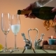Bottle of Champagne with Two Glasses. Woman Pours Champagne Into Glasses. Romantic Evening - VideoHive Item for Sale