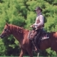 Cowboy Rider Rides a Horse, Stops and Jumps Off It. Rider Stands Next To the Horse - VideoHive Item for Sale