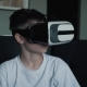 A Happy Boy with Virtual Reality Glasses at Home Playing Games and Watching Movies - VideoHive Item for Sale