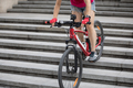 Woman freerider riding down city stairs - PhotoDune Item for Sale