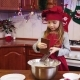 A Girl Chef Rubs Chocolate on a Grater Into Bowl - VideoHive Item for Sale