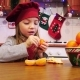 A Cheerful Girl Peels Tangerine - VideoHive Item for Sale