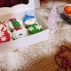 Woman´s Hands Closes Box with Amazing Christmas Cupcakes - VideoHive Item for Sale
