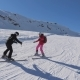 Instructor Teaches Student To Alpen Ski In The Mountains Resort In Winter - VideoHive Item for Sale