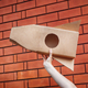 Cardboard space rocket in hand against brick wall - PhotoDune Item for Sale