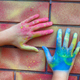 Painted hands on brick wall - PhotoDune Item for Sale
