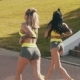 Two Running Fitness Girls Joggin in Urban City Athletic Friends Running - VideoHive Item for Sale