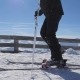 Skier At The Top Of The Mountain Fastens Ski Boots On The Ski Fastening - VideoHive Item for Sale