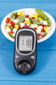 Glucose meter with result of sugar level and fresh salad with eggs and vegetables - PhotoDune Item for Sale