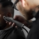 Tattoed Barber Makes Haircut for Customer at the Barber Shop By Using Hairclipper, Man's Haircut and - VideoHive Item for Sale