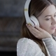 Innocent Gentle Girl with Baby Face Is Hearing Slow Music Through Headset - VideoHive Item for Sale