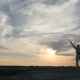 Athlete Triumphantly Raises His Hands Up at Sunset - VideoHive Item for Sale