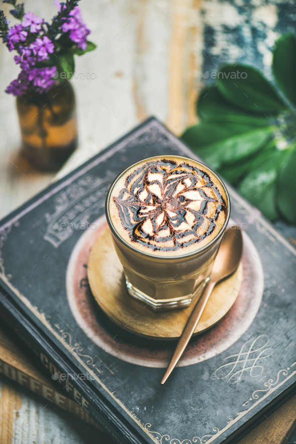Latte coffee with chocolate sauce pattern in glass, selective focus - Stock Photo - Images