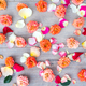 Roses and petals background. Roses and petals scattered on wooden gray background, overhead view - PhotoDune Item for Sale