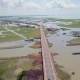 Aerial View of Chaloem Phrakiat - the Longest Bridge in Thailand. Top View of Highway Road at Thale - VideoHive Item for Sale